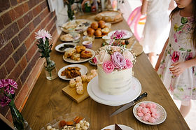 Food spread with cake and desserts for an event
