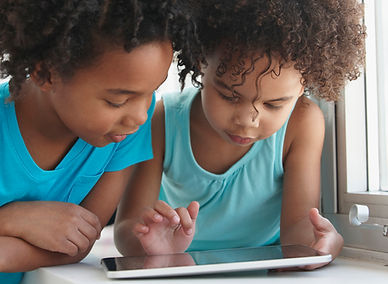 Two Friends with a Tablet