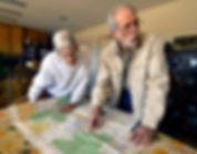 Ranchers Ray and Carol Pittman study a map of the San Augustin Plains