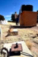 Rancher Ray Pittman checks his water tank