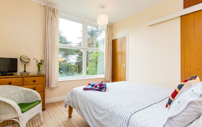 Main Bedroom with en suite and view of the sea