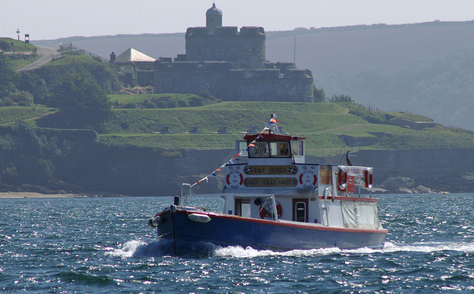 St Mawes Castle with ferry Boat