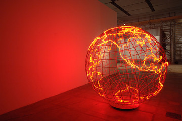 Hot Spot (2006) by Mona Hatoum, part of research on the concept of unsettled global geography, which is transmitted in Hatoum's work by making the non-visually represented borders strongly present in the viewer's mind and sensations, which in turn elicits imagining the menace of the global political situation. In her work, conveying the strong psychological effect of political formations that are the borders, the artist evokes the absent borderlines into presence, which is emotionally experienced. Their invisibility also implies the ideas of movement, instability, menace, anxiety, and reveal the implicit processes of possible 'disbordering'.