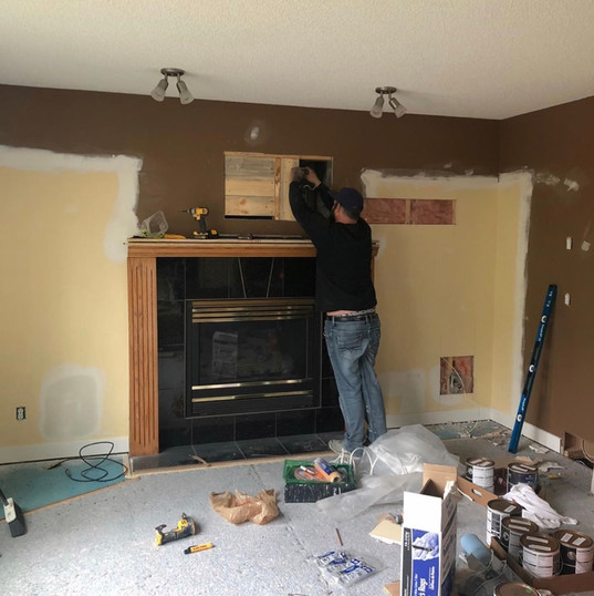 Before pic of framed out fireplace and finishes