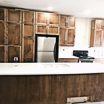 So we added a brand new kitchen. Keep swiping to see those before and progress pictures.