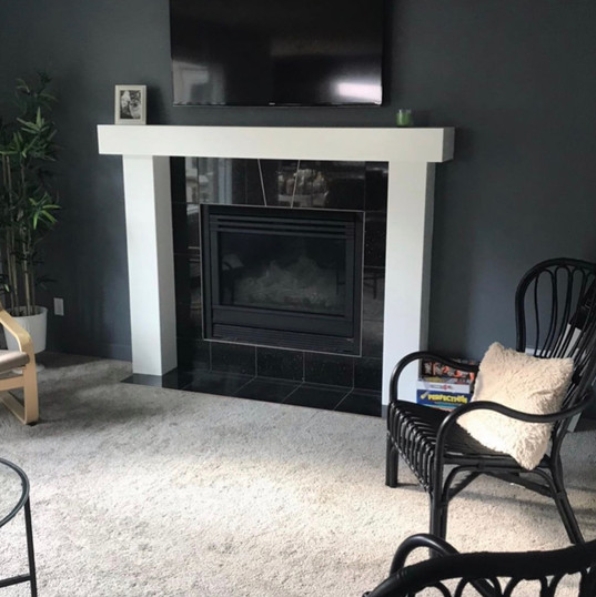 After pic of framed out fireplace and finishes (scroll for before)