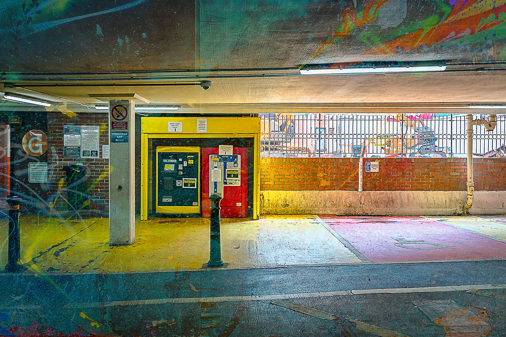 Car park, pay machine, coloured floor, strip lighting