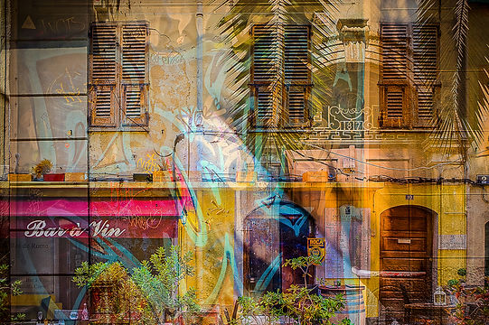 Corsican architecture meets palm fronds and street art.
