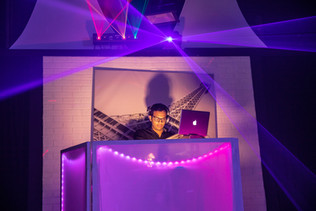 dj with purple lights show sweet 16