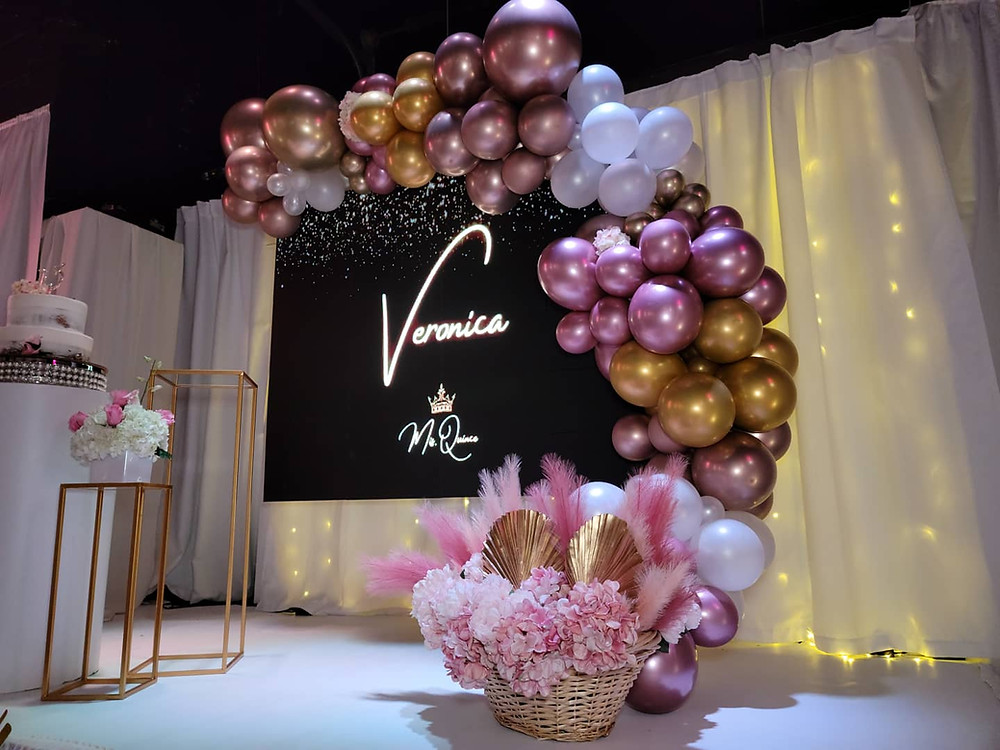 stand decorated with metallic balloons on 15th birthday