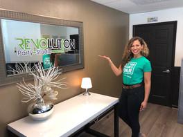 woman next to revolution party studio logo