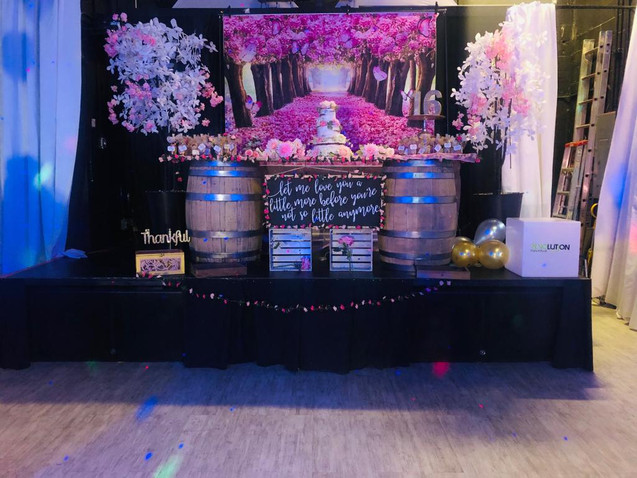 sweet 16 party decorated table with cake