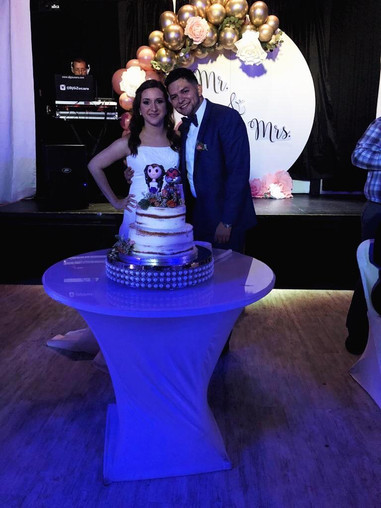Spouses with wedding cake