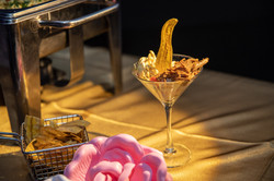 Golden food in a cocktail glass