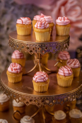 cupcakes decorated with pink cream event venue