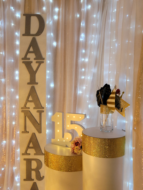 quinceanera birthday golden decoration in event venue