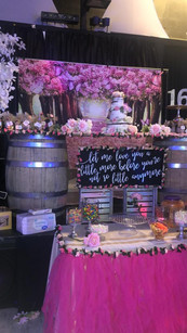 table arrangement with 3 story cake sweet 16