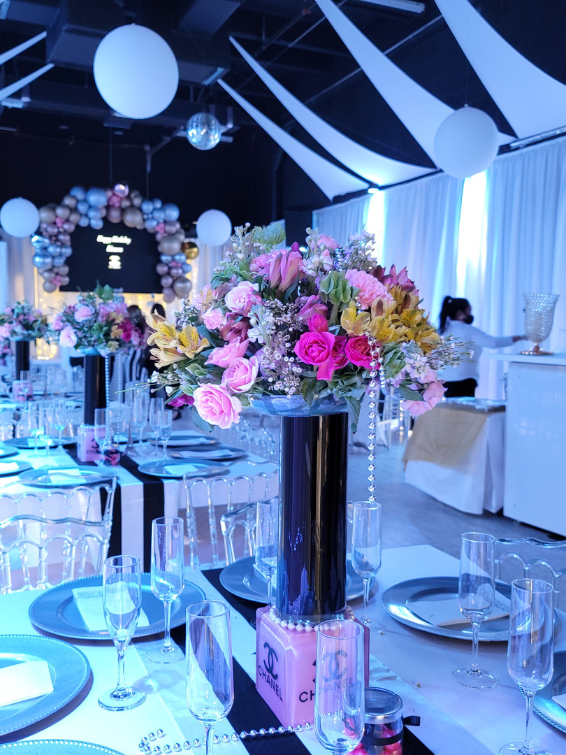 Banquet hall with blue lights decorated with flowers