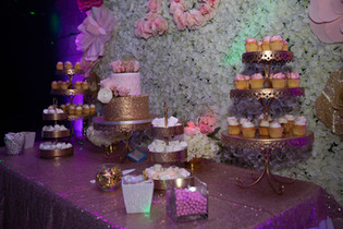 table arrangement with 3 story cake and snacks
