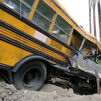 Logging Truck Slams Into School Bus Carrying Children
