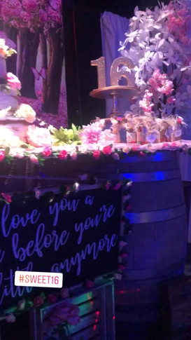 Sweet 16 pink floral table arrangement in a party venue in Kendall Miami