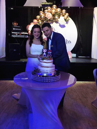 Just married cutting cake at wedding