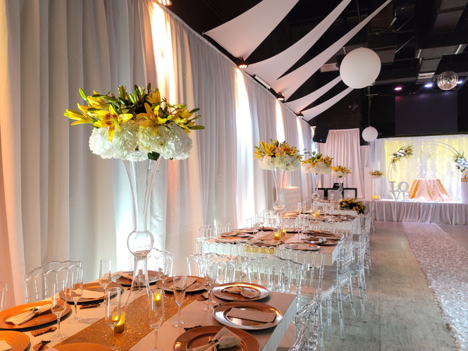 golden decoration for tables at wedding hall
