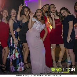 8 girls posing for a photo in a party venue