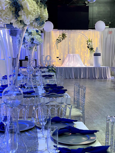 white and blue centerpiece at banquet hall