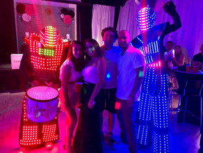 led robot with guests at neon party