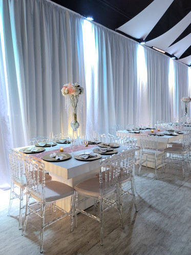 white decoration for tables at wedding venue