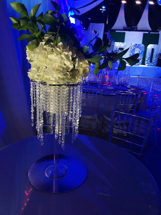 Table decoration with flowers at wedding hall