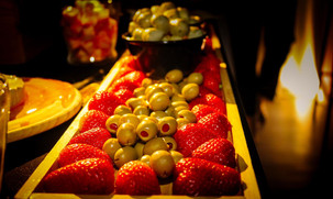 strawberries and olives in tray catering service