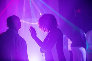 woman dancing purple lights sweet 16