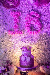 flower arrangement with 3 story cake sweet 16
