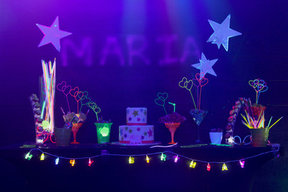 table decorated with cake thematic neon