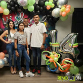 family posing with balloons arrangement 14th birthday