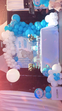 Blue and white balloon arrangement cake table