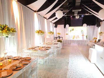 wedding decorated white in event hall in miami