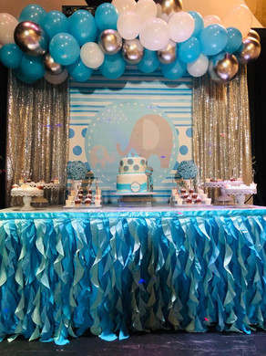 Blue cake table with blue and white balloons