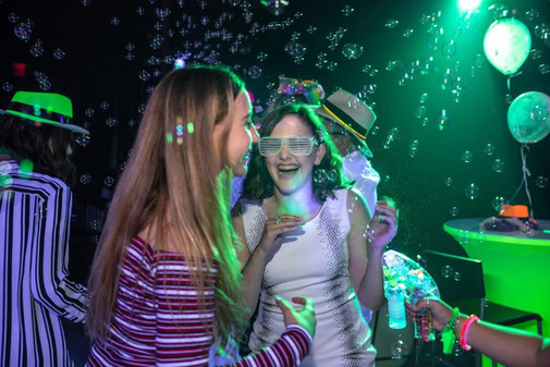 birthday girl at green neon themed party
