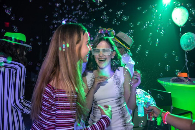 Two girls happy at a green themed party