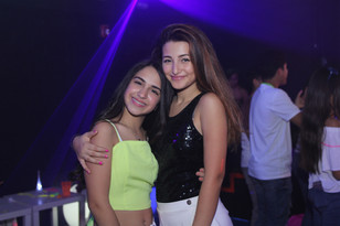birthday girl with friend at teen party