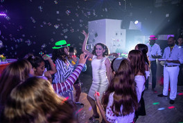guests dancing at neon themed teen party
