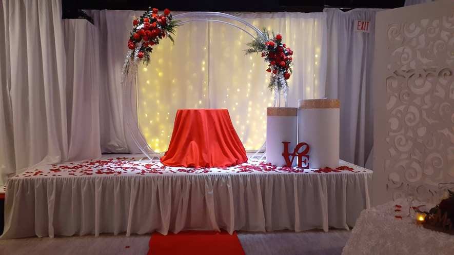 white and red stage for wedding