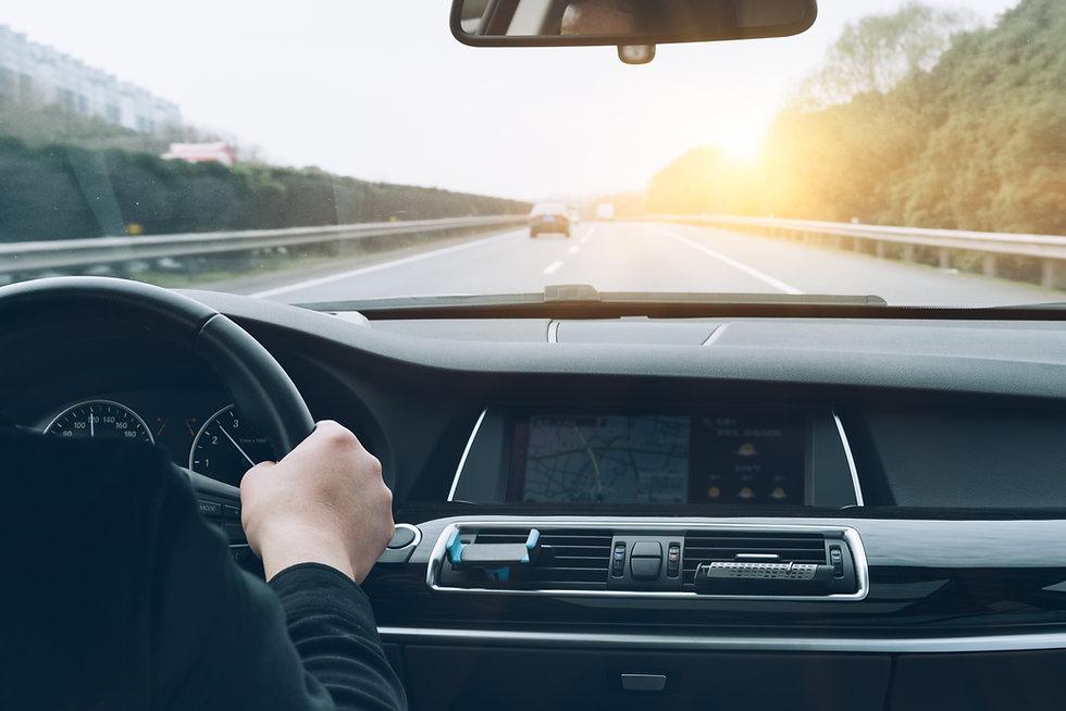 man-driving-car-from-rear-view.jpg