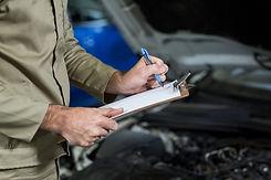 mid-section-mechanic-preparing-check-lis