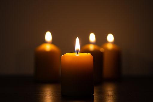 bigstock-Group-Of-Lit-Candles-Burning-I-389313454.jpg