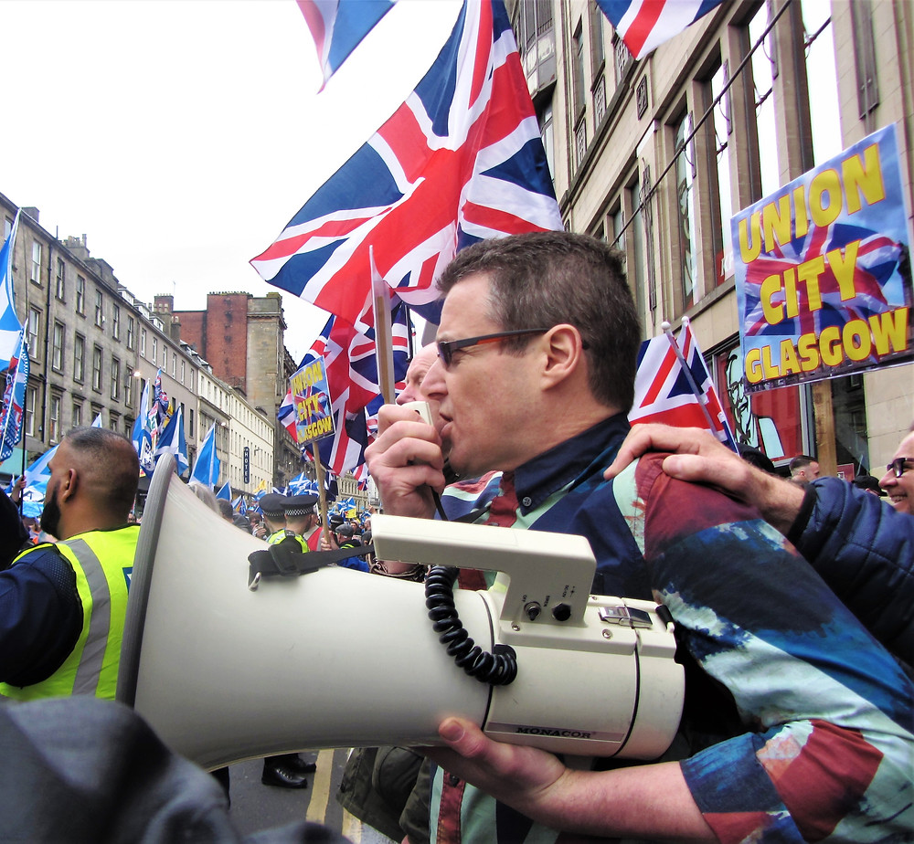Alistair McConnachie of A Force For Good addresses the March