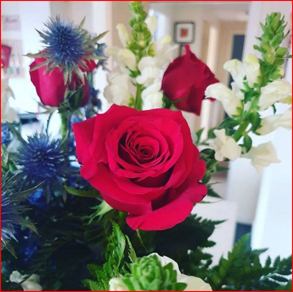 Red, White and Blue flowers presented to one of our Activists